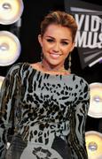 http://img279.imagevenue.com/loc239/th_393433665_Miley_Cyrus_1101_122_239lo.jpg