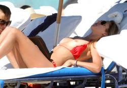 http://img279.imagevenue.com/loc486/th_260138678_lauren_stoner_bikini_topless_march19_2012_20_123_486lo.jpg